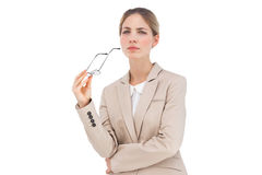 Serious businesswoman holding glasses Stock Photography
