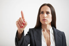 Serious businesswoman holding her forefinger Stock Images