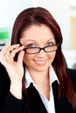 Serious businesswoman holding her glasses Stock Photo