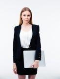 Serious businesswoman holding laptop Stock Image