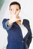 Serious businesswoman making stop sign Stock Photo