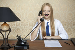 Serious businesswoman and a new contract on the desk. Serious business woman and a new contract on the desk Royalty Free Stock Photo