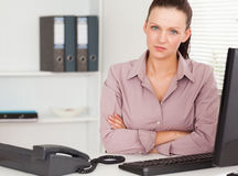 Serious businesswoman in office Stock Photo