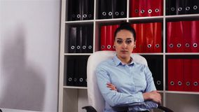 Serious businesswoman in office armchair. stock video