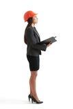 Serious businesswoman in orange hardhat Royalty Free Stock Photos