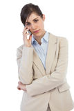 Serious businesswoman on the phone Stock Image