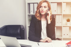 Serious businesswoman on phone Royalty Free Stock Image