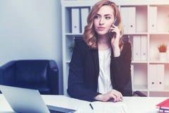Serious businesswoman on phone, toned Stock Photos