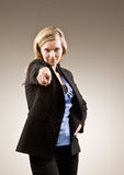 Serious businesswoman pointing accusing finger Royalty Free Stock Image