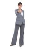 Serious businesswoman pointing at camera Stock Photos