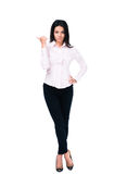 Serious businesswoman pointing finger away Stock Images