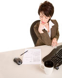 Serious Businesswoman Reading a Document Stock Photo