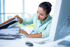 Serious businesswoman searching files Stock Photo