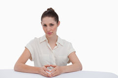 Serious businesswoman sitting Stock Photo