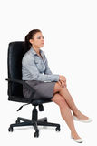 A serious businesswoman sitting on an armchair Stock Images