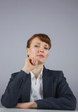 Serious businesswoman sitting at desk Royalty Free Stock Photography