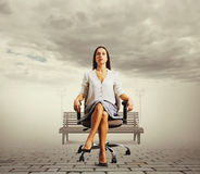 Serious businesswoman sitting Stock Image