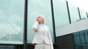 Serious businesswoman with smartphone outdoors stock video footage