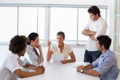 Serious businesswoman speaking to her coworkers Royalty Free Stock Photography