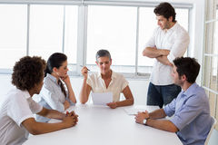 Serious businesswoman speaking to her coworkers Royalty Free Stock Photo