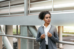 Serious businesswoman standing in airport Royalty Free Stock Images