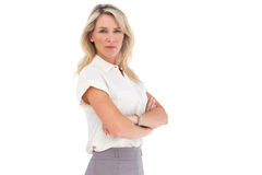 Serious businesswoman standing with arms crossed Royalty Free Stock Images