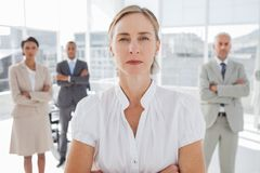 Serious businesswoman standing with arms folded Stock Photography