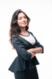 Serious businesswoman standing with arms folded Stock Photos