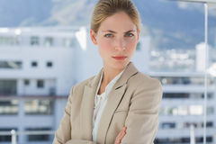 Serious businesswoman standing in the workplace Stock Image