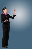 Serious businesswoman in suit gesturing with hands Royalty Free Stock Photos