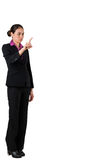 Serious businesswoman in suit pointing Royalty Free Stock Photos