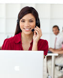 Serious Businesswoman talking on headset stock photo