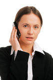 Serious businesswoman  talking on mobile phone Royalty Free Stock Photography