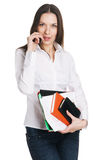 Serious businesswoman talking over a mobile phone Stock Photo