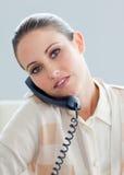 Serious businesswoman talking on phone Stock Photo