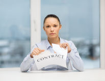 Serious businesswoman tearing contract Stock Photo
