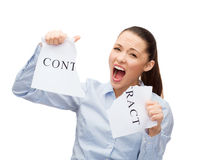 Serious businesswoman tearing contract Royalty Free Stock Photography