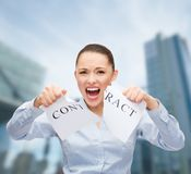Serious businesswoman tearing contract Royalty Free Stock Photos