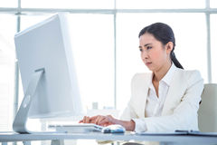 Serious businesswoman using computer Stock Photography