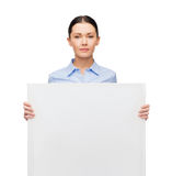 Serious businesswoman with white blank board Stock Photography