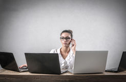 Serious businesswoman at work Stock Images