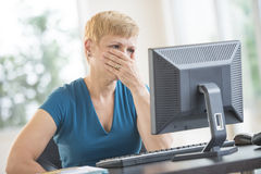 Serious Businesswoman Working On Computer Royalty Free Stock Images