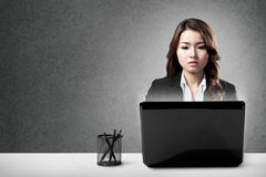 Serious businesswoman working hard Stock Images