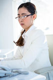 Serious businesswoman working at her desk Royalty Free Stock Images
