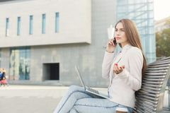 Caucasian businesswoman working with laptop outdoors Royalty Free Stock Image