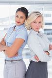 Serious businesswomen with arms folded Royalty Free Stock Photo