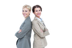 Serious businesswomen standing back on back Stock Images