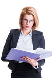 Serious bussiness woman reading contracts Stock Photo