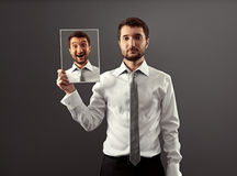 Calm businessman hiding his gladness Stock Images