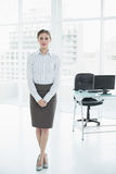 Serious calm businesswoman posing standing in her office Stock Photo